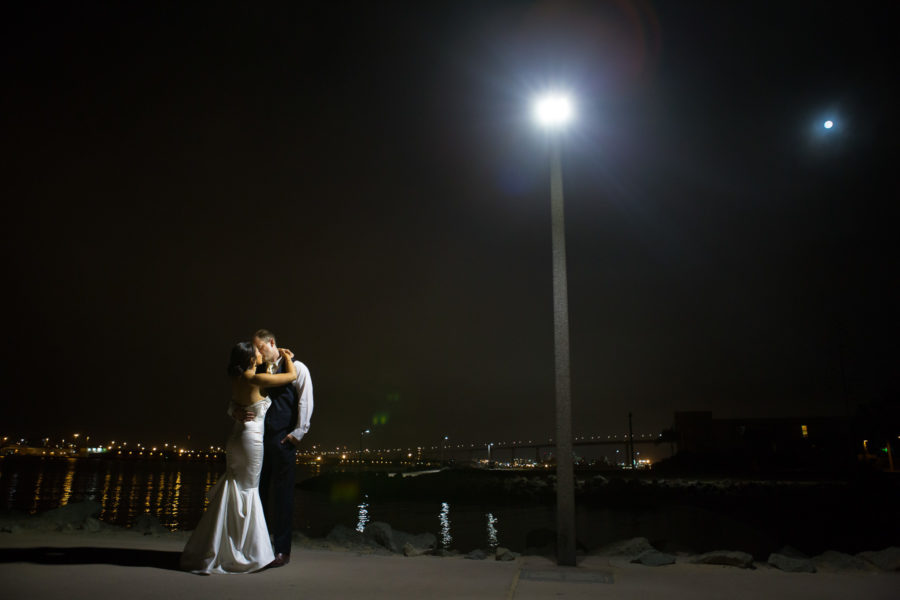 night wedding shot of couple under lamp