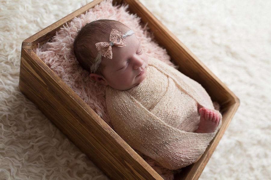 beautiful newborn girl sleeping swaddled