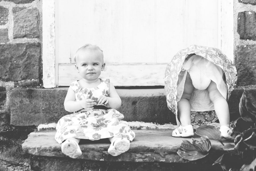 twin baby girls sitting on step