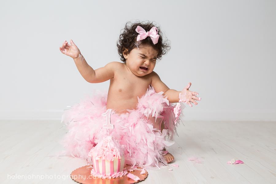 baby girl crying during cake smash