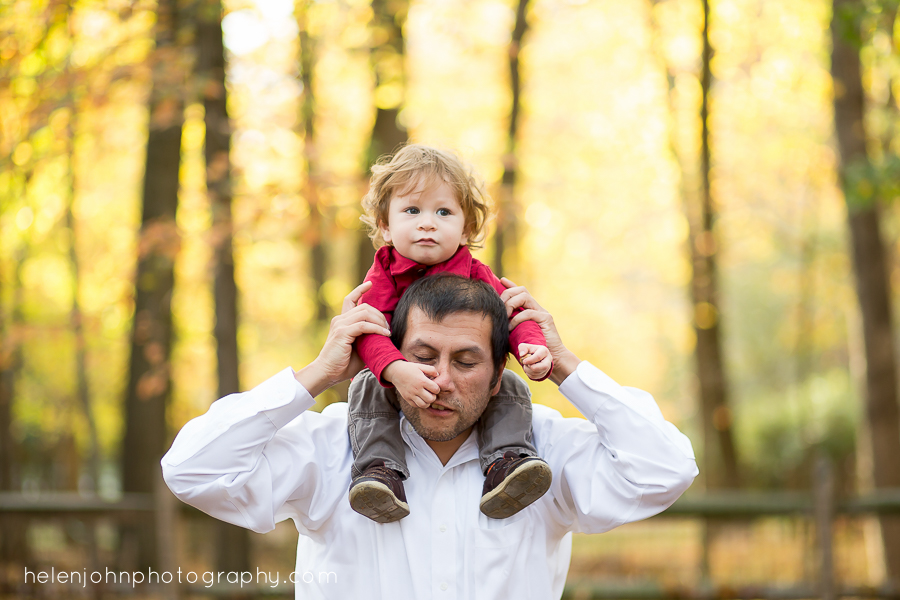 little boy with hand in dads nose