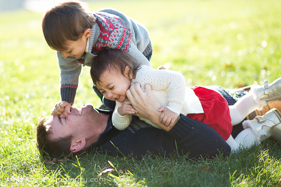 kids wrestling with their dad