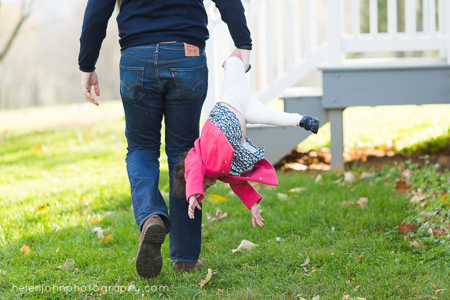 dad carring daughter by one leg