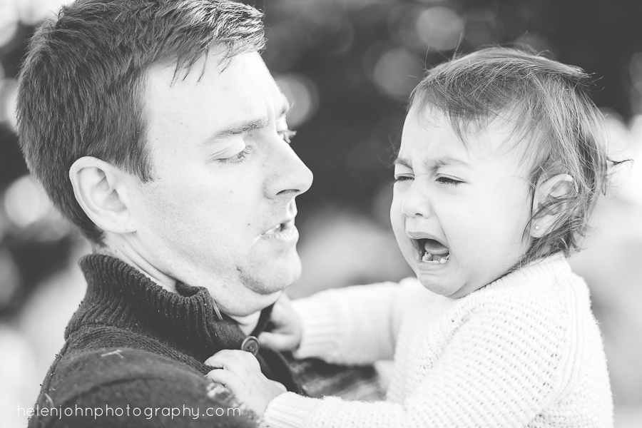 baby girl screaming in dads arms