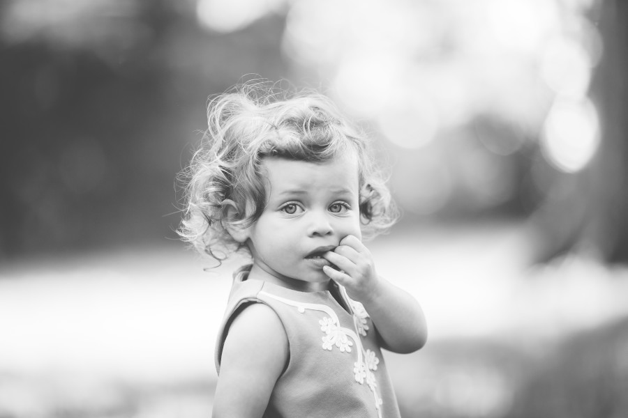 black and white close up of beautiful little girl with curls