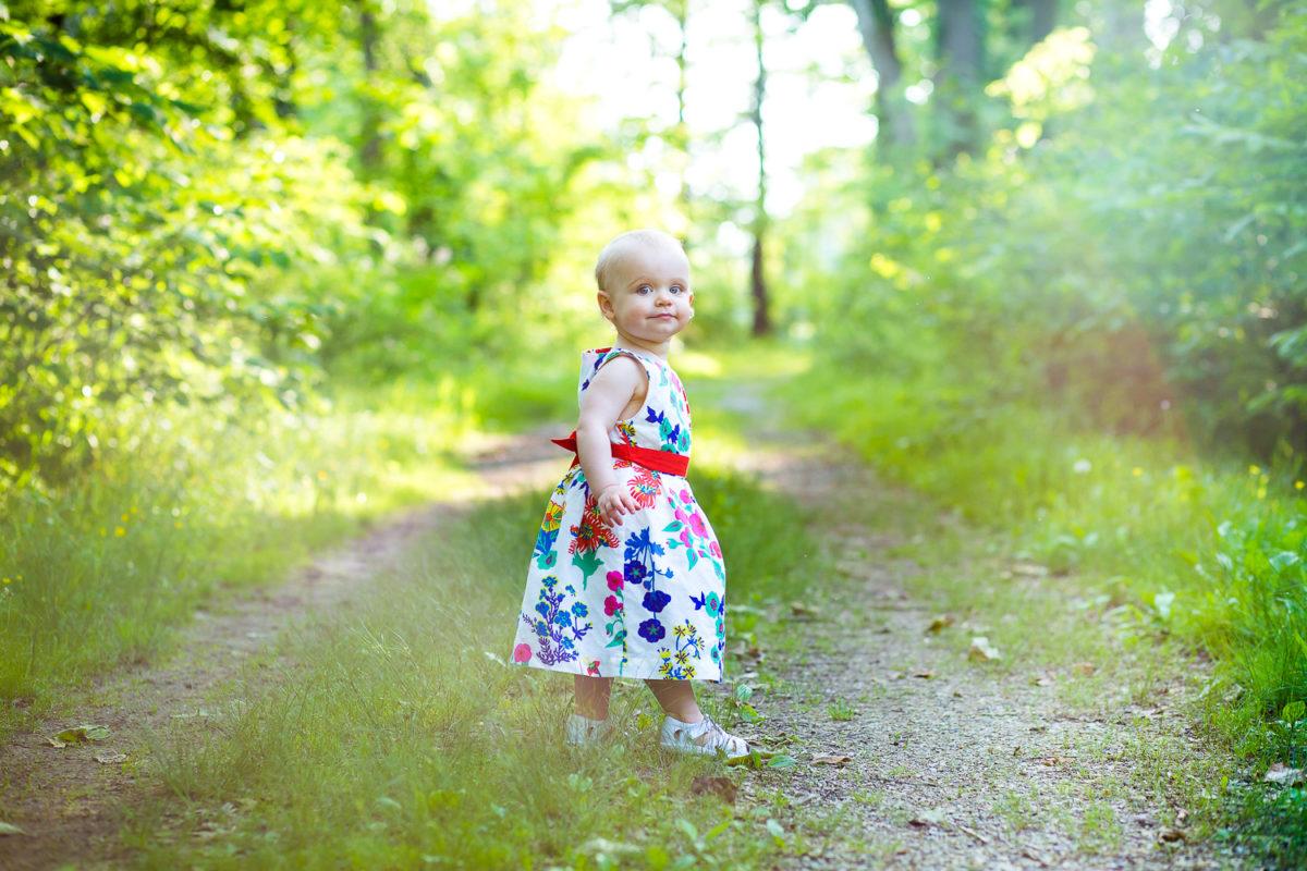 baby girl walking down dirt path