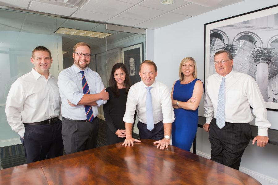group shot of team in meeting room