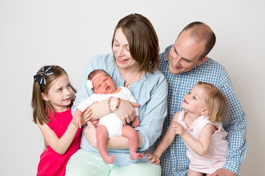 newborn funny face with family