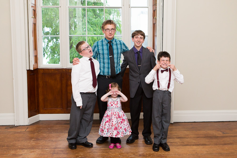 five kids making funny faces