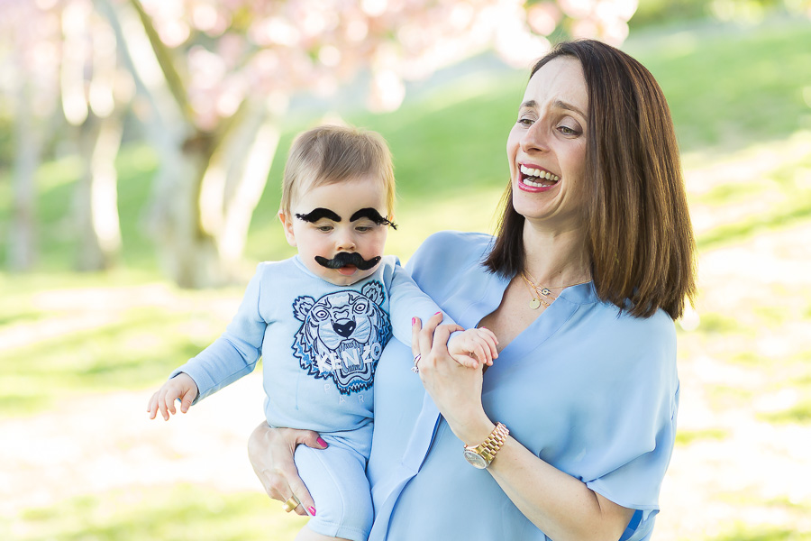 baby with stick on eyebrows and mustache