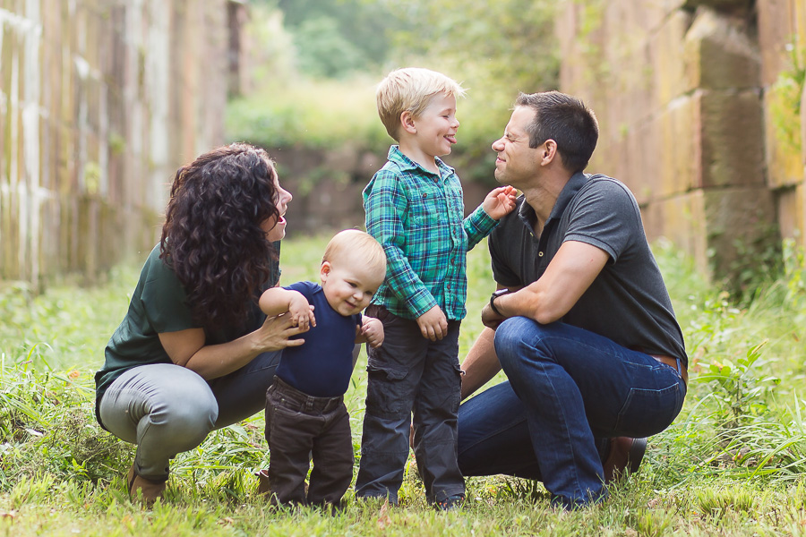 boys sticking tongue out at dad