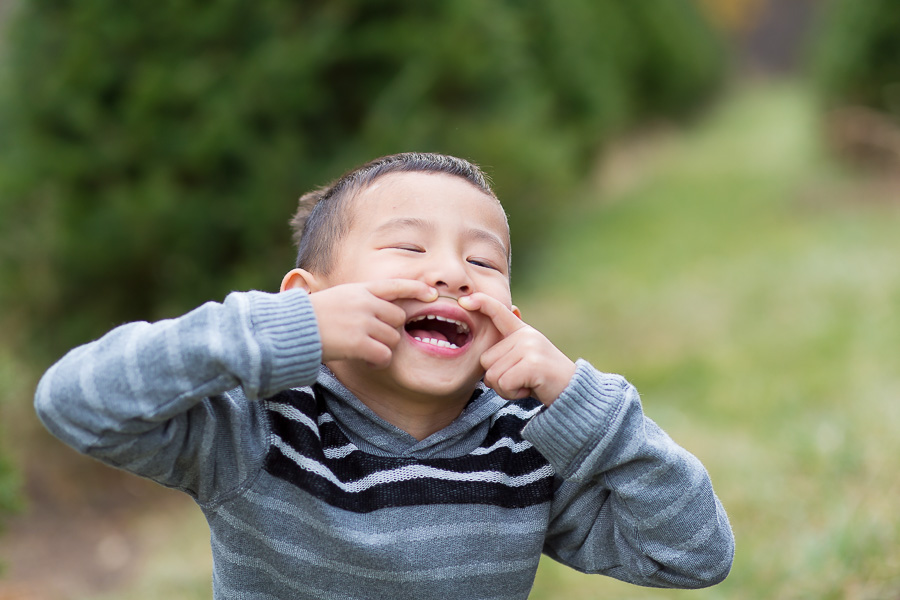 4 year old with pretend mustache laughing