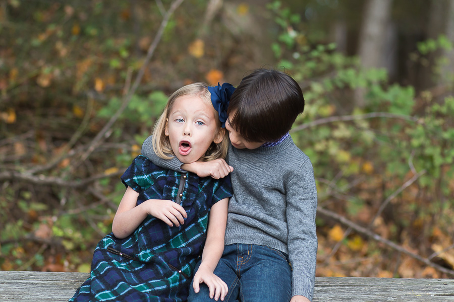 big brother squeezing baby sister