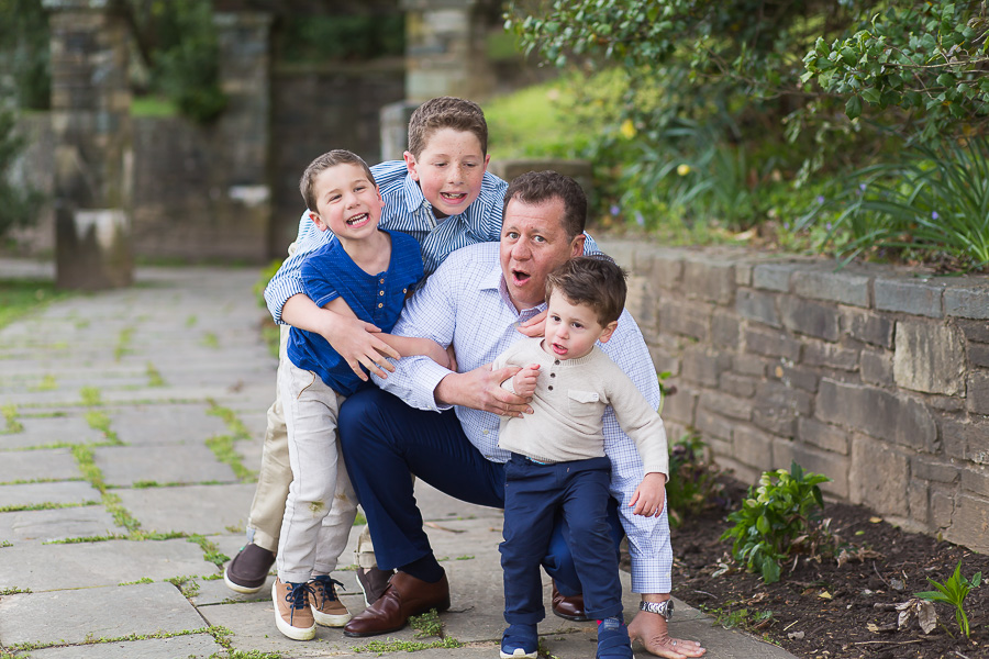 three sons making dad fall over