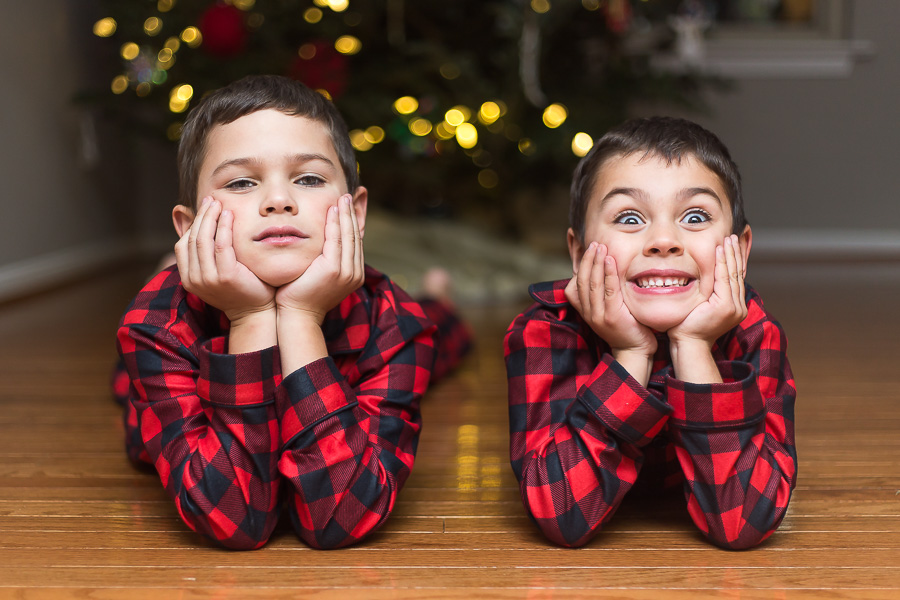 brothers in christmas pjs making crazy faces