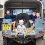 travel photography england little boys in land rovercountryside