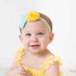 baby girl smiling during cake smash