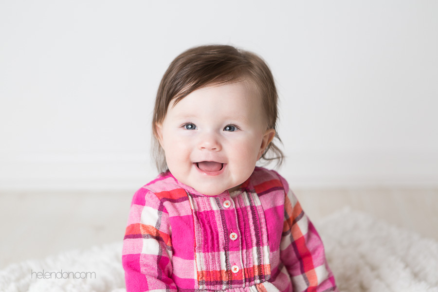 adorable baby girl in pink shirt smiling