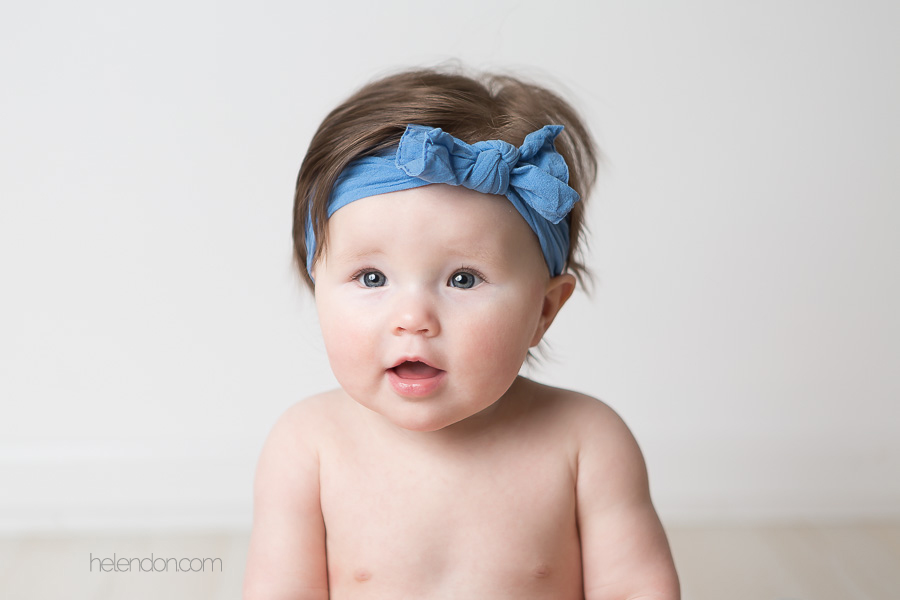 super cute baby girl with blue headband