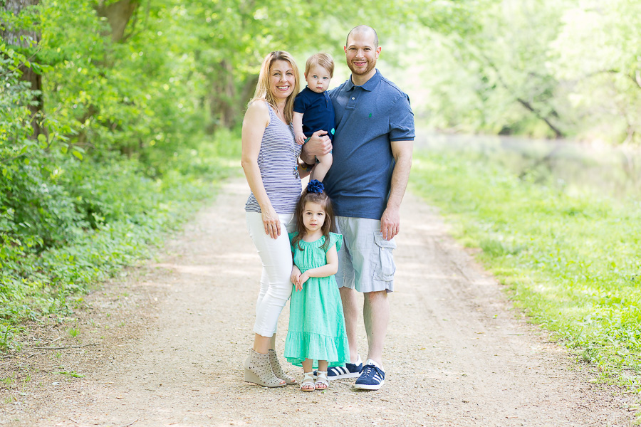 family of four portrait on dirt path