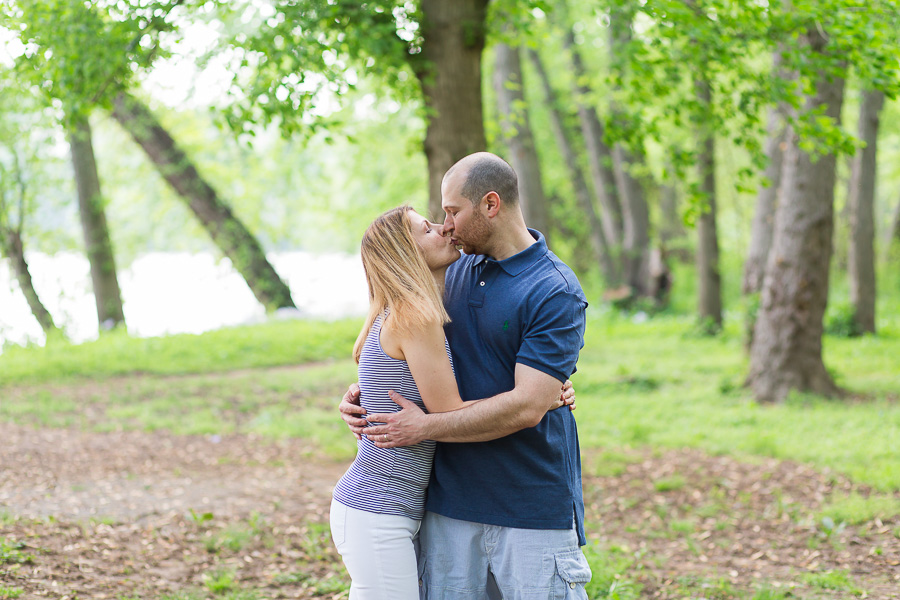 parents kissing in woods
