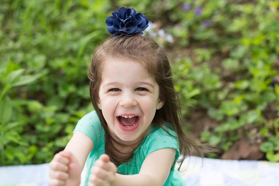 close up of 3 year old girl laughing