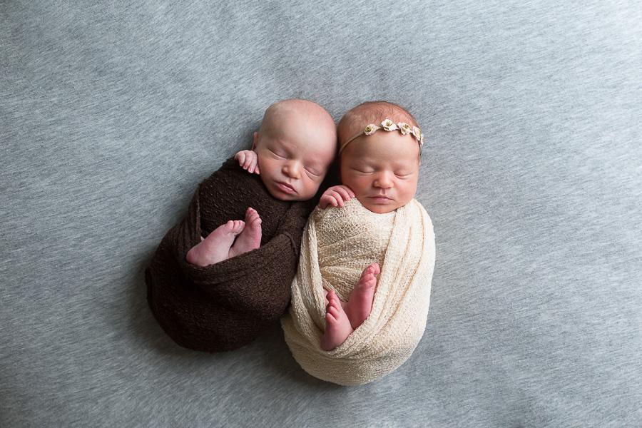 newborn twins boy and girl swaddled