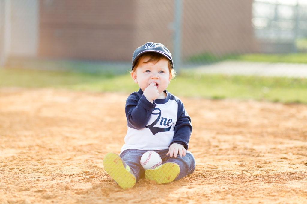 one year old boy on baseball diamond