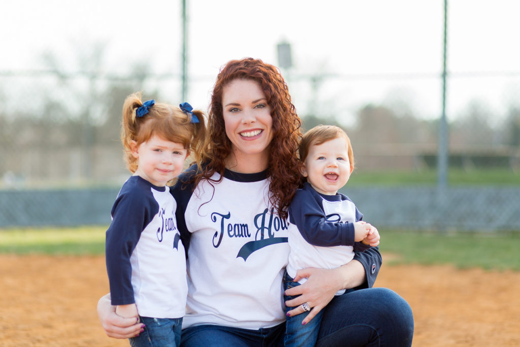 mother with two children in baseball shirts
