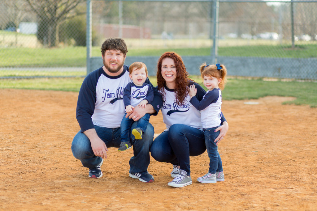 family of four in baseball shirts