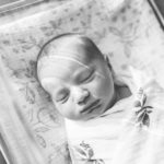 black and white photo of newborn at hosptial