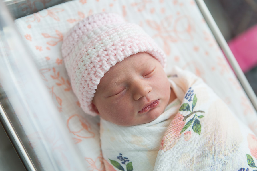 newborn baby sleeping in bassinet at hospital