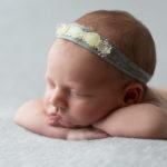 7 day old baby sleeping head on hands