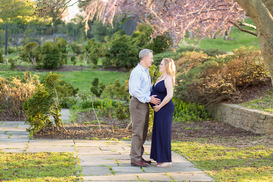 gorgeous spring garden and maternity couple portrait