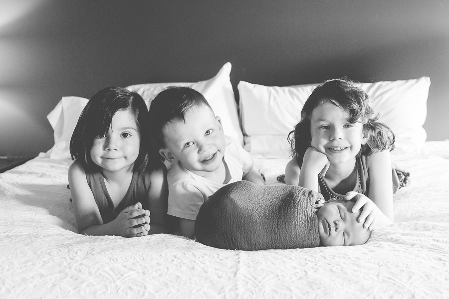 black and white of 4 young siblings