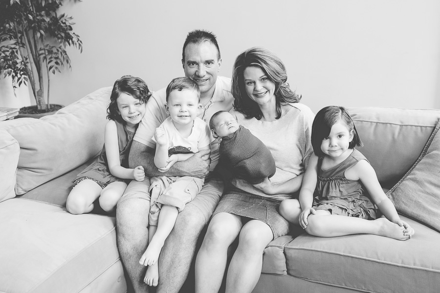 portrait of family of six with newborn baby